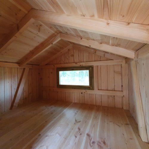 La partie couchage pouvant accueillir un matelas 140x190